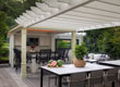 Outdoor dining by the pergola