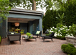 Interlocking brick work sets a tone for this beautifully designed outdoor living space