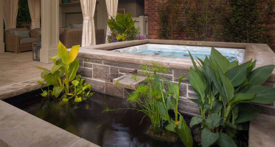 Photo slideshow of Artistic Gardens' design projects: long swimming pool with flagstone surround, privacy screen