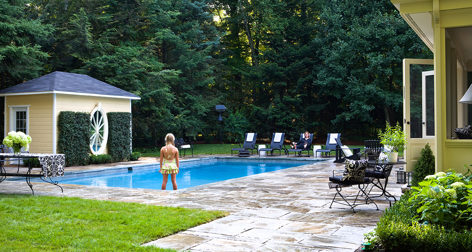 Photo slideshow of Artistic Gardens' design projects: another view of the flagstone-surrounded pool with bath cottage and extended pathway